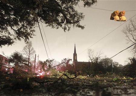 Downed trees and power lines along with a damaged traffic light caused by a Christmas Day tornado are seen along Dauphin Street in Mobile, Alabama December 25, 2012. REUTERS/Marvin Gentry