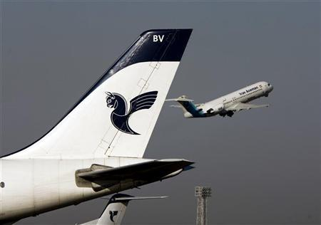 An Iranian Aseman Airlines' Fokker 100 takes off as an Iran Air aircraft is seen in the foreground at Tehran's international airport August 6, 2007. REUTERS/Morteza Nikoubazl