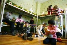 Orphan children play in their bedroom at an orphanage in the southern Russian city of Rostov-on-Don, December 19, 2012. REUTERS/Vladimir Konstantinov