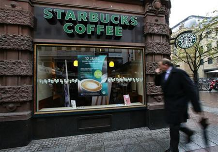 A man walks past a branch of Starbucks in Frankfurt October 30, 2012. REUTERS/Ralph Orlowski/Files