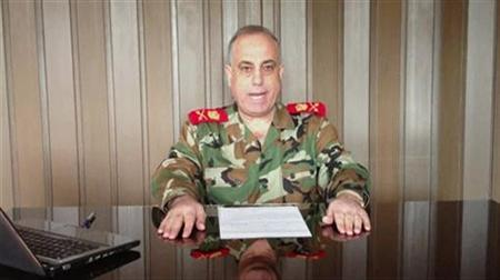 General Abdelaziz Jassim al-Shalal, the head of Syria's military police, speaks in a video uploaded on a social media website December 26, 2012. REUTERS/Social Media Website via Reuters TV