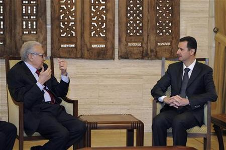 Syria's President Bashar al-Assad (R) meets International peace envoy for Syria Lakhdar Brahimi in Damascus December 24, 2012 in this handout photograph released by Syria's national news agency SANA. REUTERS/Sana