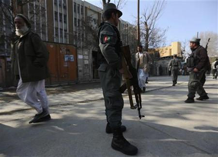 Afghan policemen stand guard at the site of an incident inside the compound where a U.S. advisor was killed in Kabul, December 24, 2012. REUTERS/Omar Sobhani