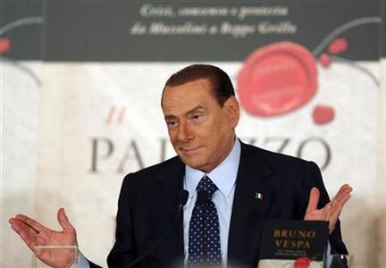 Former Italian Prime Minister Silvio Berlusconi gestures during a book launch of his friend, TV presenter Bruno Vespa, in Rome December 12, 2012. REUTERS/Alessandro Bianchi