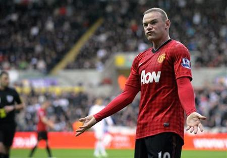 Manchester United's Wayne Rooney gestures before being booked for a foul, during their English Premier League soccer match at the Liberty Stadium in Swansea, South Wales, December 23, 2012. REUTERS/Rebecca Naden