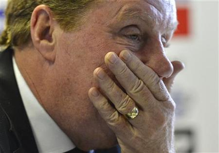 Harry Redknapp attends a news conference where he was officially unveiled as the new manager of Queen's Park Rangers soccer club at their training ground in west London November 26, 2012. REUTERS/Toby Melville/Files