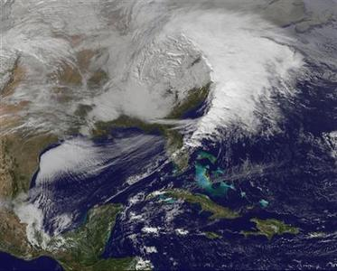 Storm clouds are seen on the east coast of the United States in this NASA handout satellite image taken at 1955 GMT, December 26, 2012. The severe winter weather that hit parts of the central and southern United States on Christmas Day moved eastward on Wednesday, causing flight delays and dangerous road conditions in the Northeast and Ohio Valley. REUTERS/NASA/NOAA/GOES Project/Handout