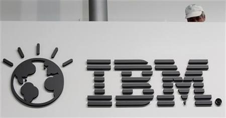 A worker is pictured behind a logo at the IBM stand on the CeBIT computer fair in Hanover February 26, 2011. REUTERS/Tobias Schwarz/Files