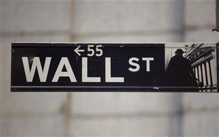 The Wall Street sign is seen near the New York Stock Exchange, November 19, 2012. REUTERS/Chip East/Files