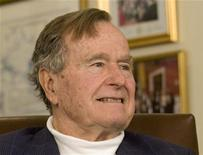 Former President George H.W. Bush smiles as he listens to Republican presidential candidate Mitt Romney speak as he met with Bush to pick up his formal endorsement in Houston March 29, 2012. REUTERS/Donna Carson