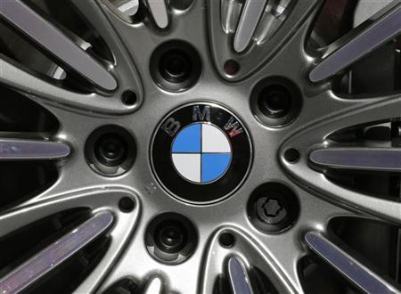 A BMW logo is seen on the rim of a BMW 650i xDrive car on media day at the Paris Mondial de l'Automobile, September 28, 2012. REUTERS/Christian Hartmann