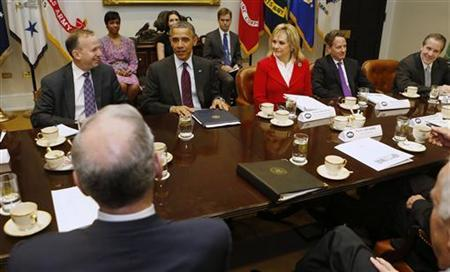 U.S. President Barack Obama (2nd L, facing camera) meets with members of the National Governors Association (NGA) Executive Committee in the Roosevelt Room of the White House in Washington, December 4, 2012. With a few weeks remaining before the onset of ''fiscal cliff,'' a bipartisan delegation of governors is set to meet Tuesday with Obama and congressional leaders in search of some answers about the impact of deficit reduction measures on their state budgets, which rely heavily on federal aid. From L-R are: Chairman Delaware Governor Jack Markell, Obama, Vice Chair Oklahoma Governor Mary Fallin and U.S. Treasury Secretary Timothy Geithner. REUTERS/Larry Downing (UNITED STATES - Tags: POLITICS BUSINESS)