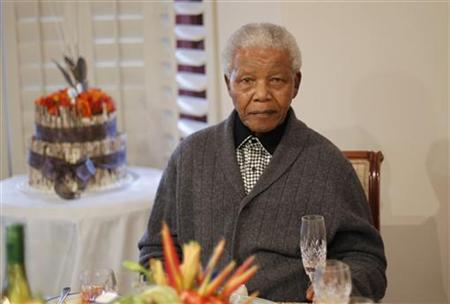 Former South African president Nelson Mandela looks on as he celebrates his birthday at his house in Qunu, Eastern Cape July 18, 2012. South Africans celebrated Nelson Mandela's 94th birthday on Wednesday with giant cakes, mass renditions of ''Happy Birthday'' and 67 minutes of good deeds - one for each year of the anti-apartheid leader's struggle against white-minority rule. REUTERS/Siphiwe Sibeko (SOUTH AFRICA - Tags: ANNIVERSARY POLITICS)