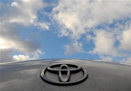 A Toyota Logo is pictured on a Prius car at a Toyota dealership in west London February 9, 2010. REUTERS/Toby Melville