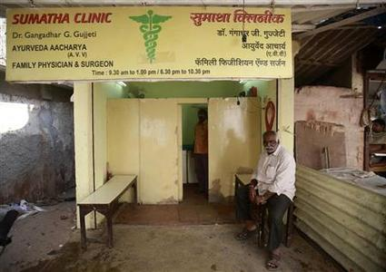 A patient waits outside a doctor's clinic at a residential area in Mumbai December 24, 2012. REUTERS/Danish Siddiqui