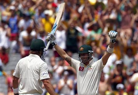 Australia's captain Michael Clarke (R) celebrates with team mate Shane Watson after reaching his century during the second day of the second cricket test against Sri Lanka at the Melbourne Cricket Ground December 27, 2012. REUTERS/David Gray