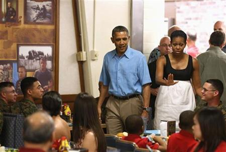 U.S. President Barack Obama and first lady Michelle Obama visit military personnel and their families as they walk into Anderson Hall base chow hall at the Marine Corps Base Hawaii in Kaneohe Bay, Hawaii December 25, 2012. REUTERS/Larry Downing