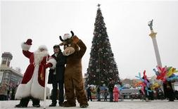 A man dressed as Father Frost, the regional version of Santa Claus, poses for a picture in Independence Square in Kiev December 30, 2008. REUTERS/Konstantin Chernichkin