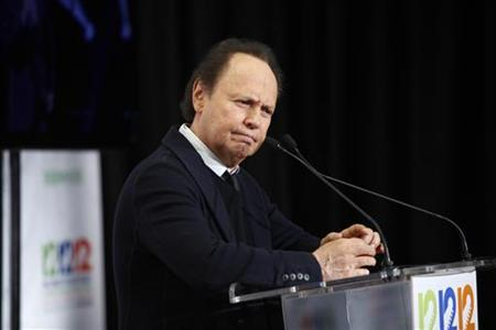 Actor Billy Crystal speaks to the media backstage during the ''12-12-12'' benefit concert for victims of Superstorm Sandy at Madison Square Garden in New York, December 12, 2012. REUTERS/Carlo Allegri