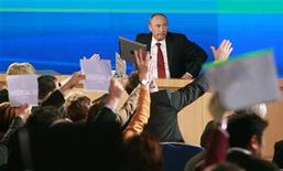 Russia's President Vladimir Putin attends his annual news conference in Moscow December 20, 2012. Any solution to the conflict in Syria must ensure President Bashar al-Assad's forces and his opponents do not simply swap roles and fight on forever, Putin said on Thursday. REUTERS/Maxim Shemetov (RUSSIA - Tags: POLITICS)