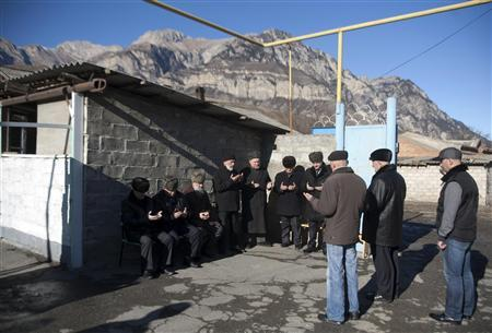 People pray during the funeral of Ibragim Dudarov, North Ossetia's deputy mufti, in the village of Chmi outside Vladikavkaz, December 27, 2012. REUTERS/Kazbek Basayev