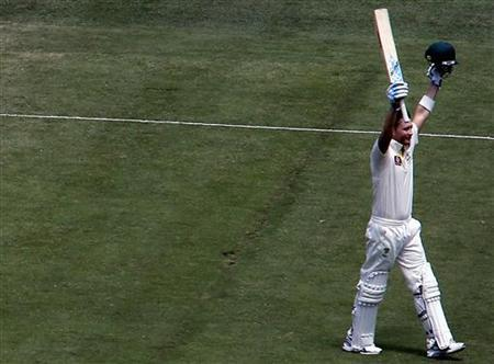 Australia's captain Michael Clarke celebrates reaching his century during the second day of the second cricket test against Sri Lanka at the Melbourne Cricket Ground December 27, 2012. REUTERS/David Gray