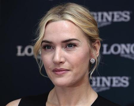 British actress Kate Winslet attends the opening of a Longines flagship store in Hong Kong December 9, 2012. REUTERS/Bobby Yip