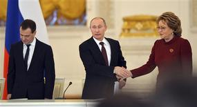 Russian President Vladimir Putin (C), Prime Minister Dmitry Medvedev (L) and speaker of the Federation Council Valentina Matviyenko attend a session of the State Council at the Kremlin in Moscow December 27, 2012. REUTERS/Natalia Kolesnikova/Pool