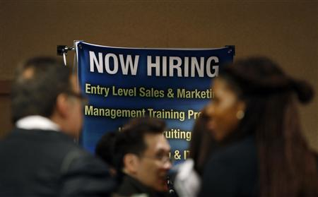 Job seekers stand in line to meet with prospective employers at a career fair in New York City in this file photo taken October 24, 2012. REUTERS/Mike Segar/Files