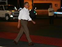 Il presidente degli Stati Uniti Barack Obama in partenza da Honolulu, Hawaii. REUTERS/Larry Downing