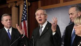 "Senate Majority Leader Harry Reid (D-NV) speaks to the media on a ""fiscal cliff"" alongside (L-R) Sen. Dick Durbin (D-IL), Sen. Charles Schumer (D-NY) and Sen. Patty Murray (D-WA) on Capitol Hill in Washington, December 20, 2012. REUTERS/Yuri Gripas"