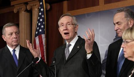 Senate Majority Leader Harry Reid (D-NV) speaks to the media on a ''fiscal cliff'' alongside (L-R) Sen. Dick Durbin (D-IL), Sen. Charles Schumer (D-NY) and Sen. Patty Murray (D-WA) on Capitol Hill in Washington, December 20, 2012. REUTERS/Yuri Gripas