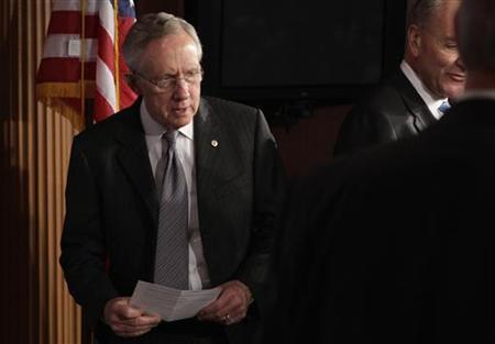 Senate Majority Leader Harry Reid (D-NV) arrives at a news conference on a ''fiscal cliff'' on Capitol Hill in Washington, December 20, 2012. REUTERS/Yuri Gripas