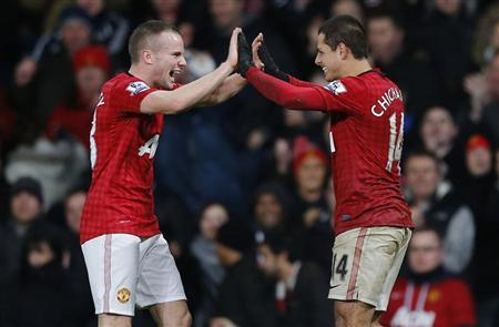 Manchester United's Javier Hernandez (R) celebrates with Tom Cleverley aftrer scoring during their English Premier League match against Newcastle United at Old Trafford in Manchester, northern England December 26, 2012. REUTERS/Phil Noble