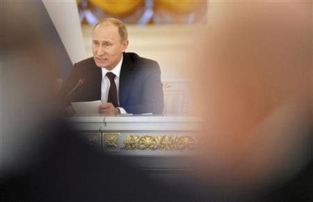Russian President Vladimir Putin speaks during a session of the State Council at the Kremlin in Moscow December 27, 2012. REUTERS/Natalia Kolesnikova/Pool