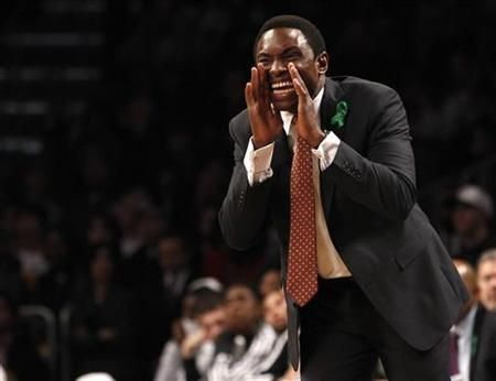 Brooklyn Nets head coach Avery Johnson shouts instructions to his players in the second quarter of their NBA basketball game against the Boston Celtics in New York, December 25, 2012. REUTERS/Adam Hunger