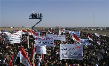 Protesters take part in a demonstration in Ramadi, 100 km (62 miles) west of Baghdad, December 26, 2012. REUTERS/Stringer
