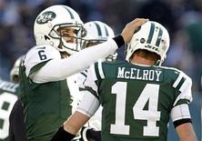 New York Jets quarterback Mark Sanchez pats quarterback Greg McElroy on the helmet after a scoring drive against the San Diego Chargers during the first quarter of their NFL football game in East Rutherford, New Jersey December 23, 2012. REUTERS/Adam Hunger