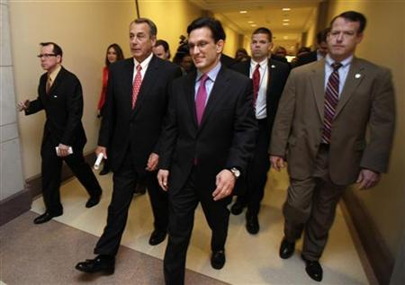 U.S. House Speaker John Boehner (R-OH) (2nd L) and House Majority Leader Eric Cantor (R-VA) (3rd R) leave after a news conference on the ''fiscal cliff'' on Capitol Hill in Washington, December 21, 2012. REUTERS/Yuri Gripas