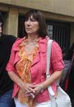 Un tribunal argentino sentenció el jueves a una ex ministra de Economía del Gobierno de Néstor Kirchner a cuatro años de prisión por haber ocultado el origen ilícito de miles de pesos hallados en el baño de su despacho oficial. Imagen de la ex ministra Felisa Miceli al llegar al tribunal en Buenos Aires el 27 de diciembre. REUTERS/Stringer