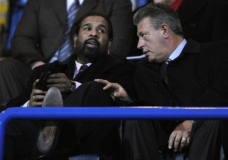 Blackburn Rovers' joint owner Balaji Rao (L) of Venky's Ltd gestures at a soccer match in Blackburn, northern England February 2, 2011. REUTERS/Nigel Roddis/Files