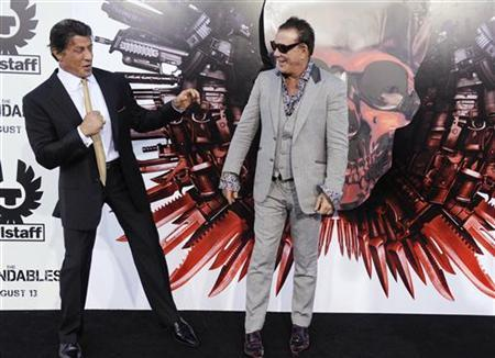 Cast members Sylvester Stallone (L) and Mickey Rourke attend the premiere of the film ''The Expendables'' in Los Angeles August 3, 2010. REUTERS/Phil McCarten/Files