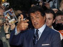 "U.S. actor Sylvester Stallone poses with fans as he arrives for the German premiere of his movie ""The Expendables"" in Berlin in this August 6, 2010 file photo. A federal judge has reaffirmed his decision to dismiss a lawsuit accusing Stallone of copying someone else's screenplay to make his popular 2010 movie ""The Expendables."" U.S. District Judge Jed Rakoff in Manhattan on December 27, 2012 rejected claims of copyright infringement damages by Marcus Webb, who contended that the movie's screenplay contained 20 ""striking similarities"" to his own ""The Cordoba Caper."" REUTERS/Thomas Peter/Files"