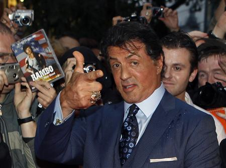 U.S. actor Sylvester Stallone poses with fans as he arrives for the German premiere of his movie ''The Expendables'' in Berlin in this August 6, 2010 file photo. A federal judge has reaffirmed his decision to dismiss a lawsuit accusing Stallone of copying someone else's screenplay to make his popular 2010 movie ''The Expendables.'' U.S. District Judge Jed Rakoff in Manhattan on December 27, 2012 rejected claims of copyright infringement damages by Marcus Webb, who contended that the movie's screenplay contained 20 ''striking similarities'' to his own ''The Cordoba Caper.'' REUTERS/Thomas Peter/Files