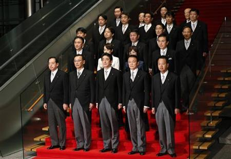 New Japanese Prime Minister Shinzo Abe (front C) and his cabinet ministers pose for a photo session after their first cabinet meeting at Abe's official residence in Tokyo December 26, 2012. REUTERS/Kim Kyung-Hoon