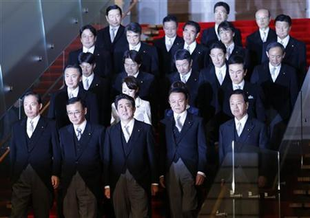 Japan's new Prime Minister Shinzo Abe (front C) and his cabinet ministers prepare for a photo session after their first cabinet meeting at Abe's official residence in Tokyo December 26, 2012. REUTERS/Kim Kyung-Hoon