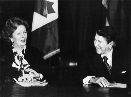 British Prime Minister Margaret Thatcher and President Reagan share a laugh during a meeting of the Allied leaders in New York on October 24, 1985. REUTERS/Chas Cancellare