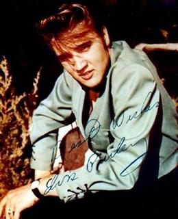 - UNDATED PUBLICITY PHOTO - Singer Elvis Presley is pictured in this undated publicity photograph which is autographed. REUTERS/Stringer