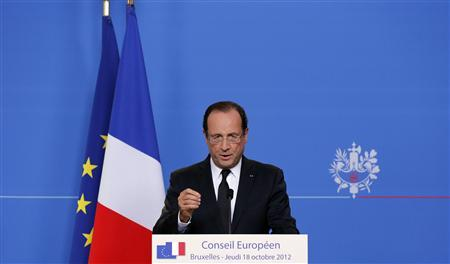 France's President Francois Hollande speaks at a news conference at the end of the first session of a two-day European Union (EU) leaders summit in Brussels October 19, 2012. REUTERS/Christian Hartmann