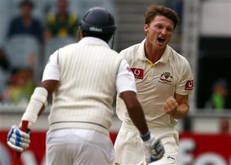 Australia's Jackson Bird (R) celebrates dismissing Sri Lanka's Thilan Samaraweera LBW for one run during the third day of the second cricket test at the Melbourne Cricket Ground December 28, 2012. REUTERS/David Gray